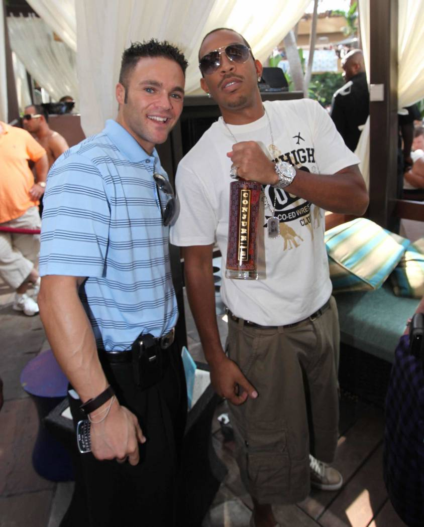 Howard Weiss, vice-president of day and nightlife activity at the M Resort, and Ludacris celebrate poolside. (Courtesy)