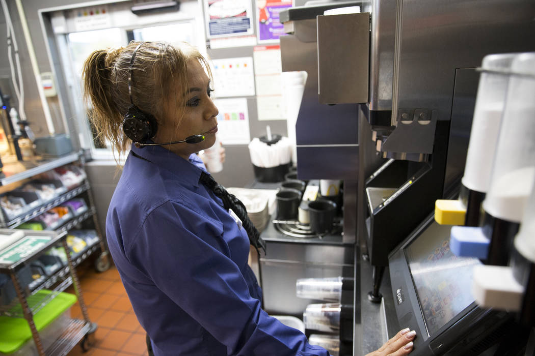Manager Martha Romero takes a drive-thru order at McDonald's, 900 S Rampart Blvd., in Las Vegas, on Wednesday, Aug. 30, 2017. McDonald's opened their doors for walk-in interviews in all Las Vegas  ...