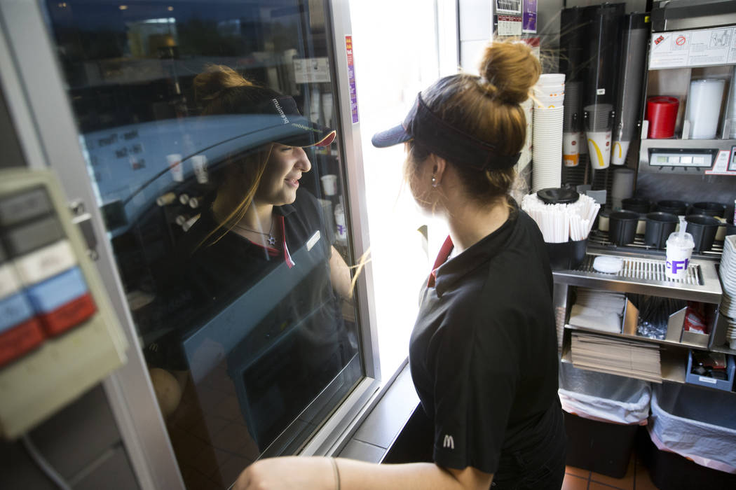 Beatriz Marques completes a drive-thru order at McDonald's, 900 S Rampart Blvd., in Las Vegas, on Wednesday, Aug. 30, 2017. McDonald's opened their doors for walk-in interviews in all Las Vegas re ...