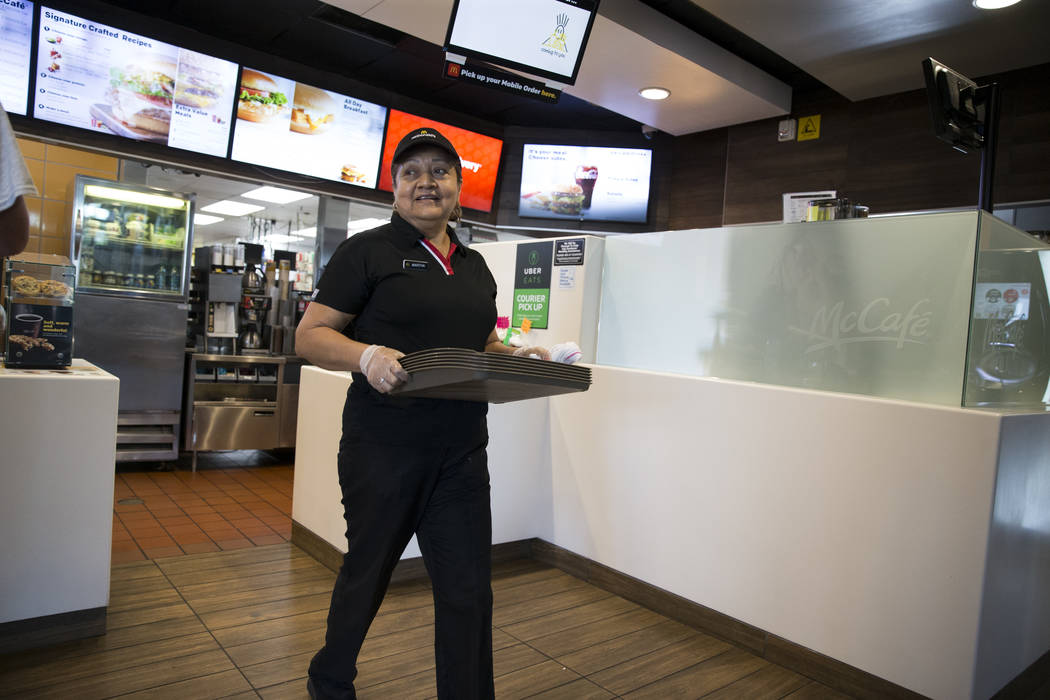 Martha Beltran walks with a stack of clean trays at McDonald's, 900 S Rampart Blvd., in Las Vegas, on Wednesday, Aug. 30, 2017. McDonald's opened their doors for walk-in interviews in all Las Vega ...