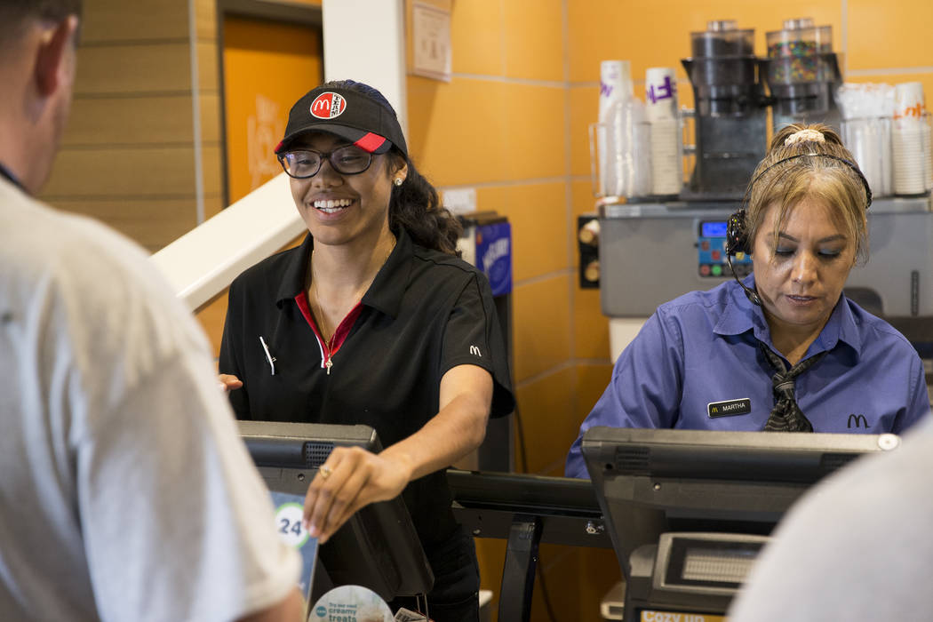 Mia Sutton, left, and Martha Romero take food orders at McDonald's, 900 S Rampart Blvd., in Las Vegas, on Wednesday, Aug. 30, 2017. McDonald's opened their doors for walk-in interviews in all Las  ...