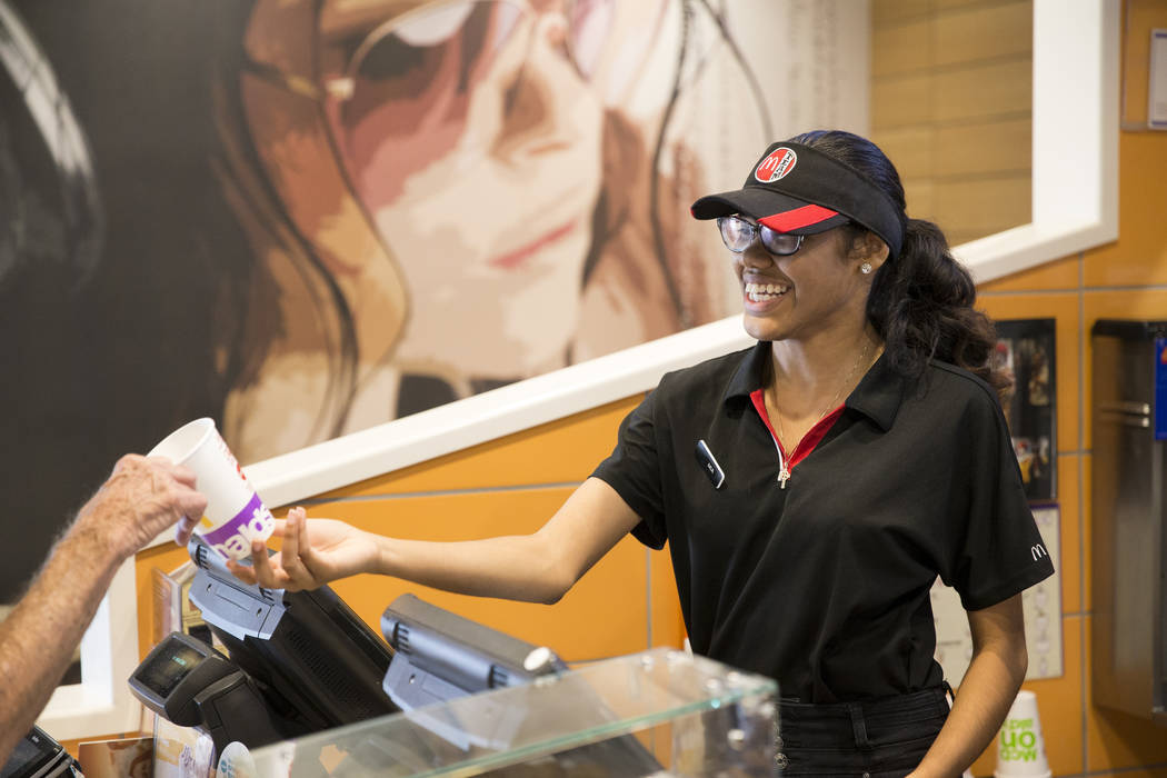 Mia Sutton hands a cup to a customer at McDonald's, 900 S Rampart Blvd., in Las Vegas, on Wednesday, Aug. 30, 2017. McDonald's opened their doors for walk-in interviews in all Las Vegas restaurant ...