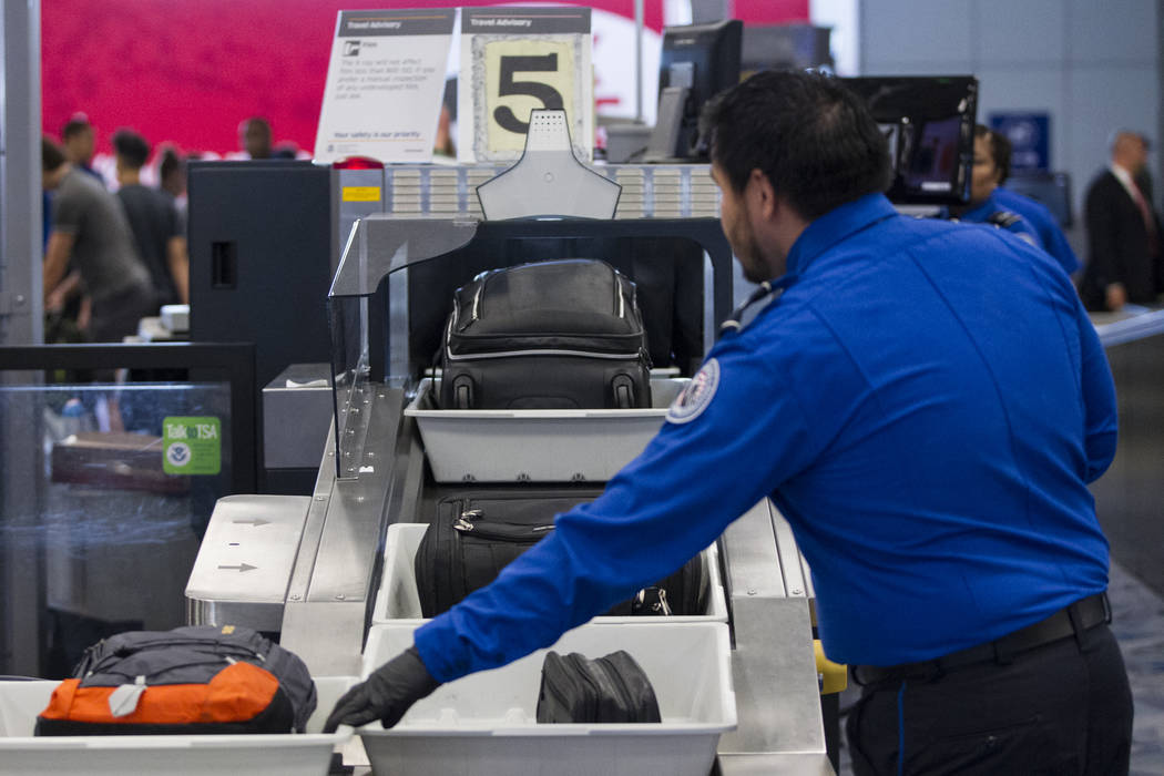 Bags are scanned in one of the new automated screening lanes at McCarran International Airport Terminal 1 in Las Vegas, on Thursday, Aug. 31, 2017. Erik Verduzco Las Vegas Review-Journal @Erik_Ver ...