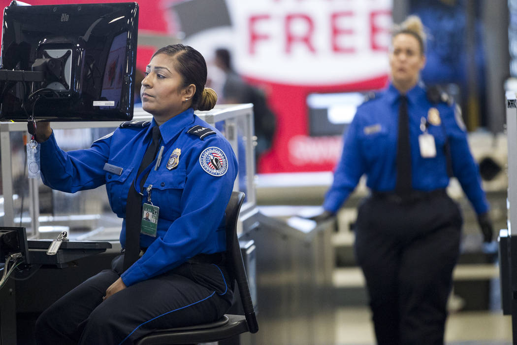 Transportation Security Administration agent Lladira Madriles monitors passenger's property entering one of the new automated screening lanes at McCarran International Airport Terminal 1 in Las Ve ...