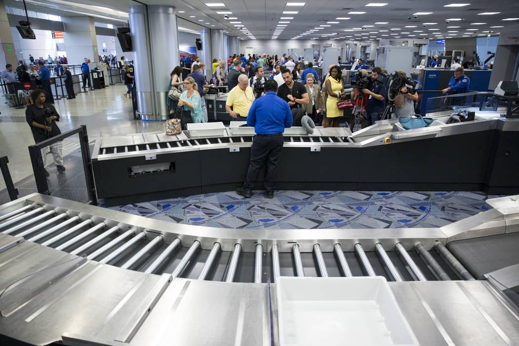 Passengers enter security to one of the new automated screening lanes at McCarran International Airport Terminal 1 in Las Vegas, on Thursday, Aug. 31, 2017. Erik Verduzco Las Vegas Review-Journal  ...
