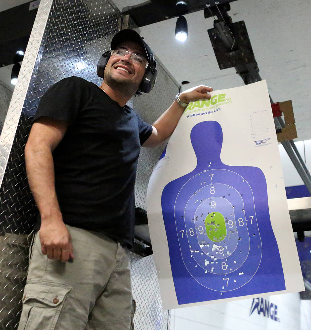 After firing an M249 SAW submachine gun, Horacio Gonzalez, 32, of Venezuela displays the grouping on his target at The Range 702 on Monday, Aug. 28, 2017. (Michael Quine/Las Vegas Review-Journal)  ...