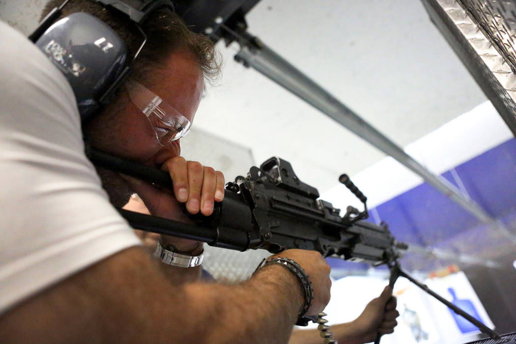 Lee Goldsmith, 39, of Liverpool, England, fires an M249 SAW submachine gun at The Range 702 on Monday, Aug. 28, 2017. (Michael Quine/Las Vegas Review-Journal) @Vegas88s