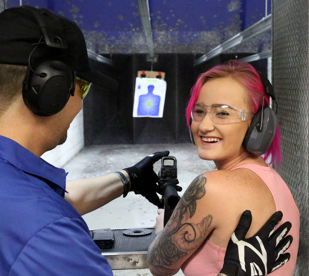 Alexus Miller of Tampa, Florida, takes instruction from Range Safety Officer Thompson Pang before firing an M4 assault rifle at The Range 702 on Monday, Aug. 28, 2017. (Michael Quine/Las Vegas Rev ...