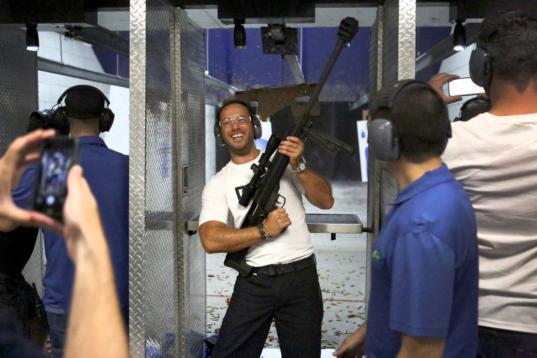 Lee Goldsmith, 39, of Liverpool, England, holds up the Barrett 50-caliber rifle after firing it at The Range 702 on Monday, Aug. 28, 2017. (Michael Quine/Las Vegas Review-Journal) @Vegas88s