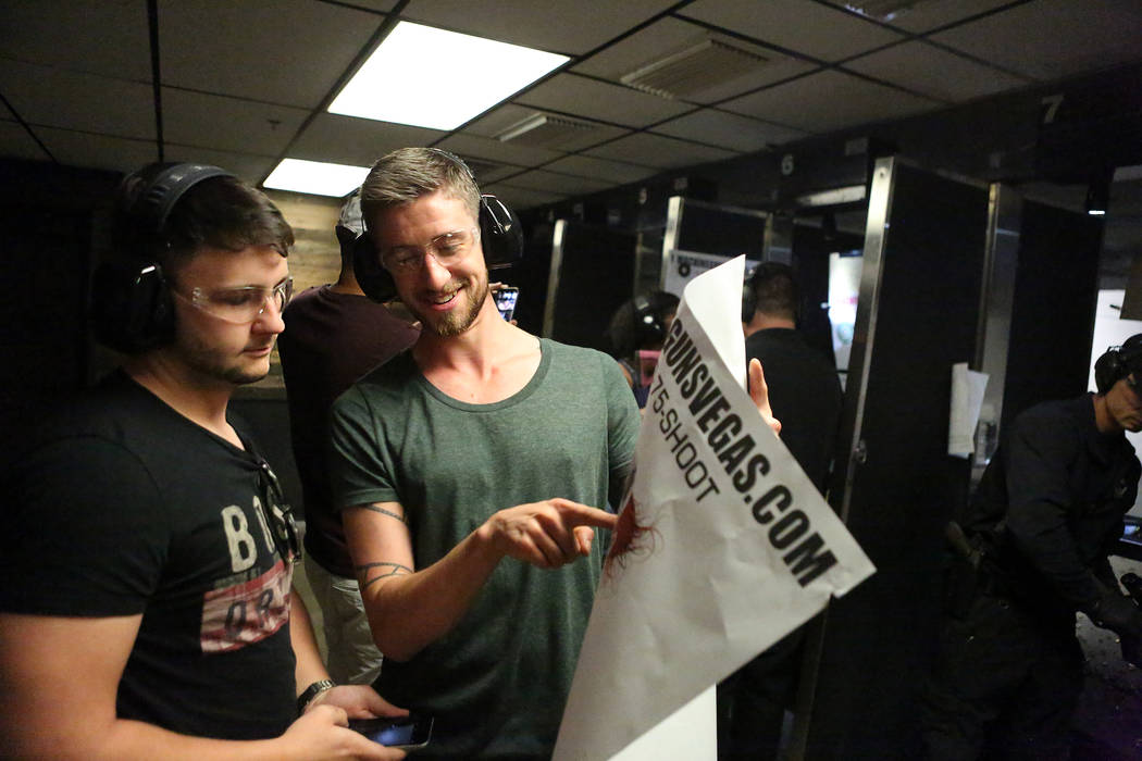 Stuart Ford points out the grouping on his target to Greg Murphy after firing a sniper rifle at Machine Guns Vegas on Wednesday, Aug. 30, 2017. Both men are from Scotland. (Michael Quine/Las Vegas ...