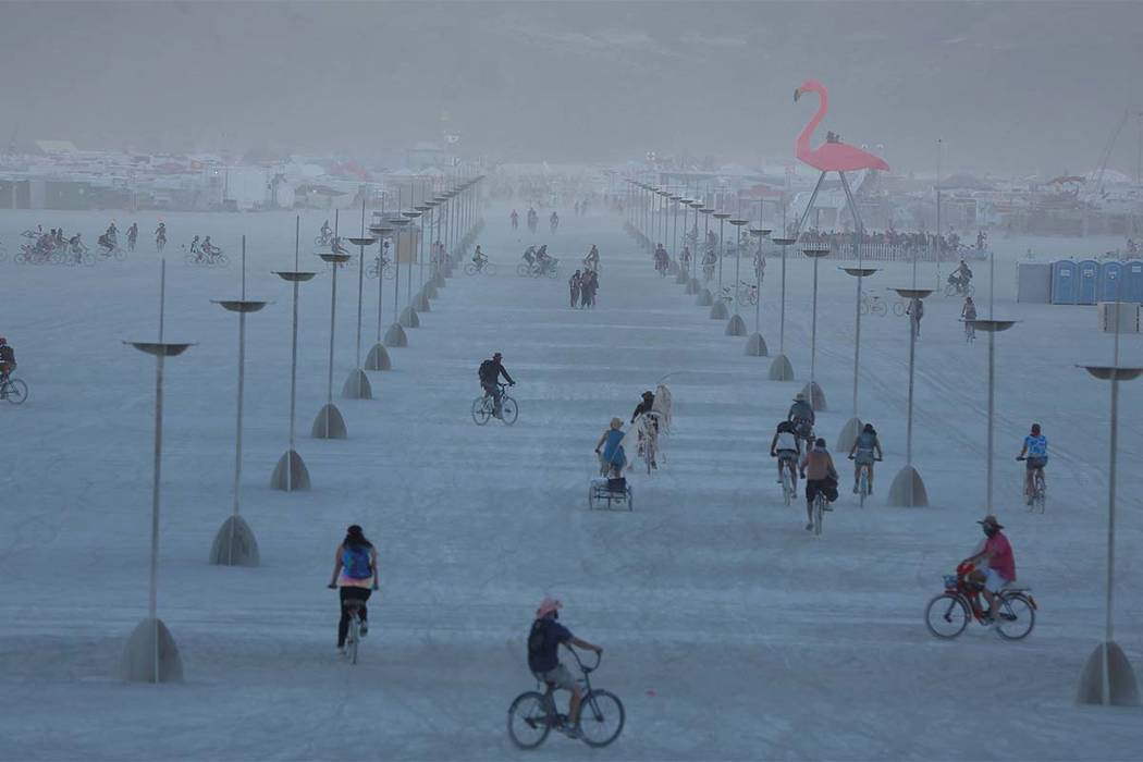 Participants explore the playa as approximately 70,000 people from all over the world gathered for the annual Burning Man arts and music festival in the Black Rock Desert near Reno, Monday, Aug. 2 ...