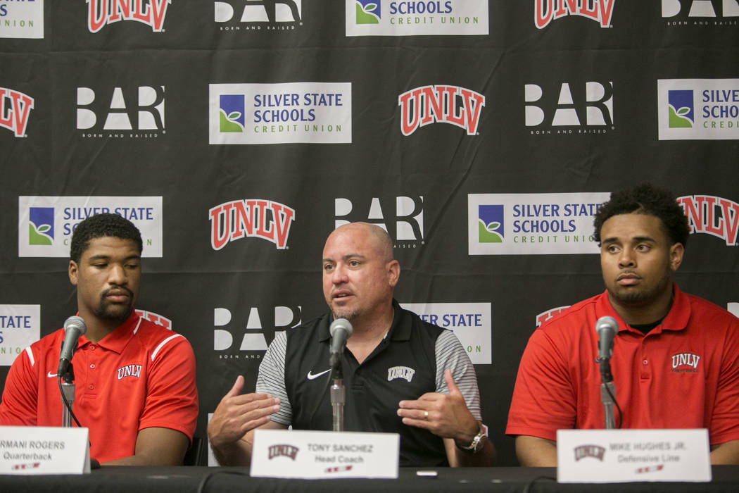 Members of the University of Nevada, Las Vegas' football team, from left: quarterback Armani Rogers, head coach Tony Sanchez, and defensive lineman Mike Huges Jr.  during a news conference at the  ...