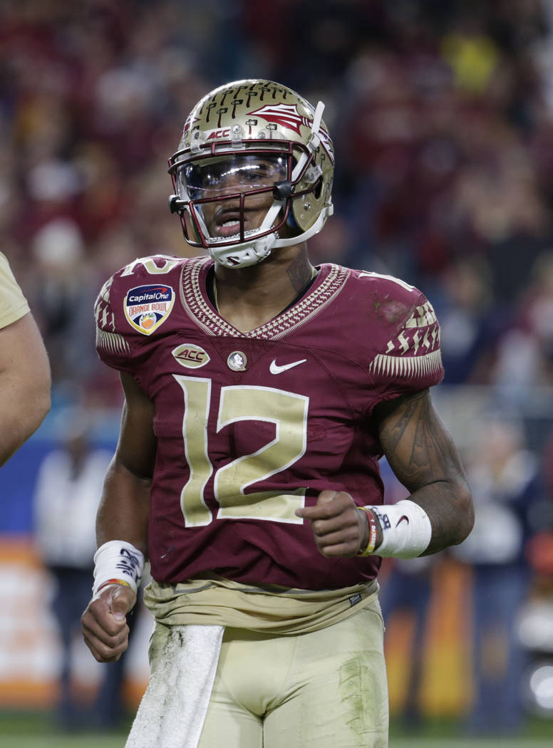 Florida State quarterback Deondre Francois (12) runs off the field, during the second half of the Orange Bowl NCAA college football game against Michigan, Friday, Dec. 30, 2016, in Miami Gardens,  ...