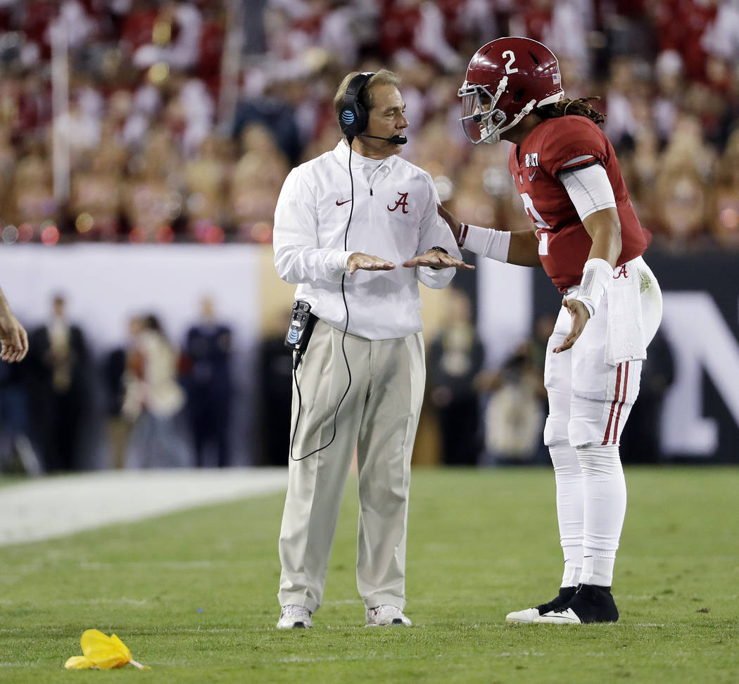 Alabama head coach Nick Saban talks to Jalen Hurts during the first half of the NCAA college football playoff championship game against Clemson Monday, Jan. 9, 2017, in Tampa, Fla. (AP Photo/David ...