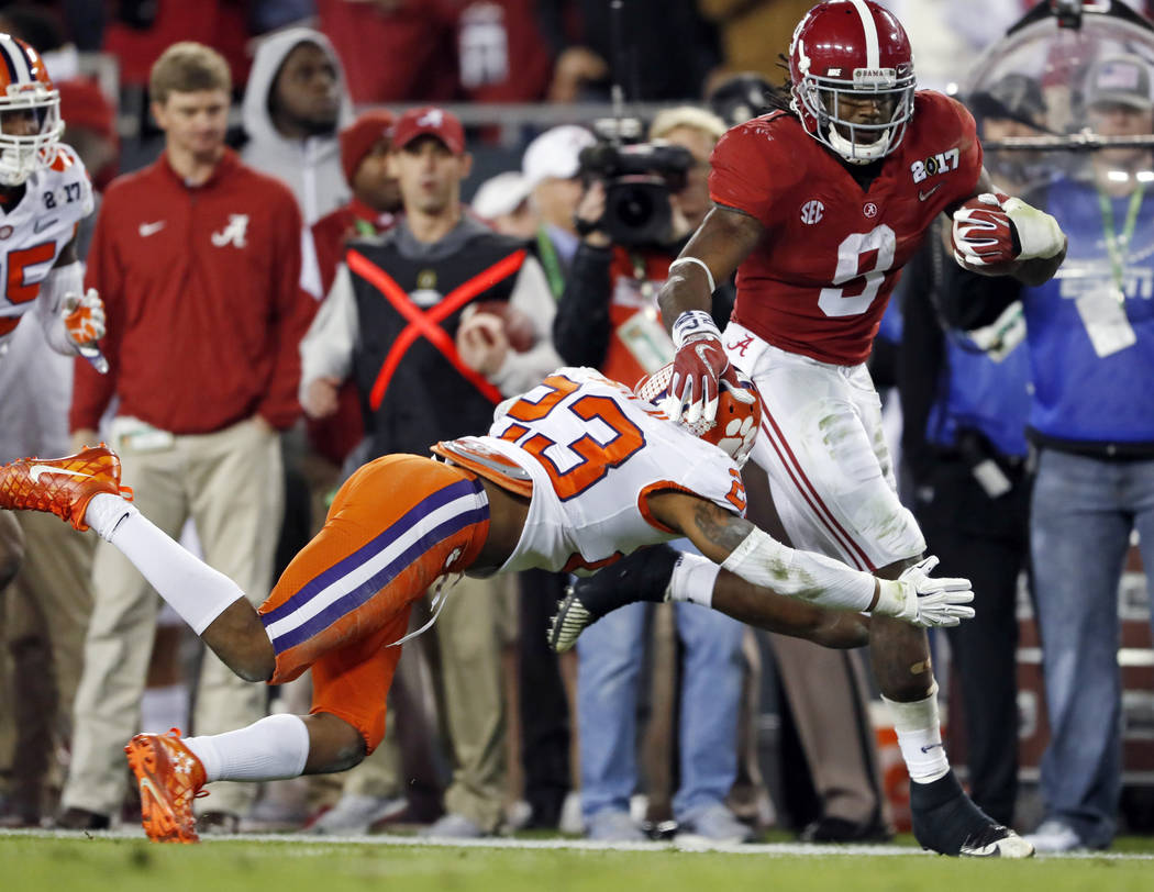 Alabama's Bo Scarbrough runs for a touchdown during the first half of the NCAA college football playoff championship game against Clemson Monday, Jan. 9, 2017, in Tampa, Fla. (AP Photo/John Bazemore)