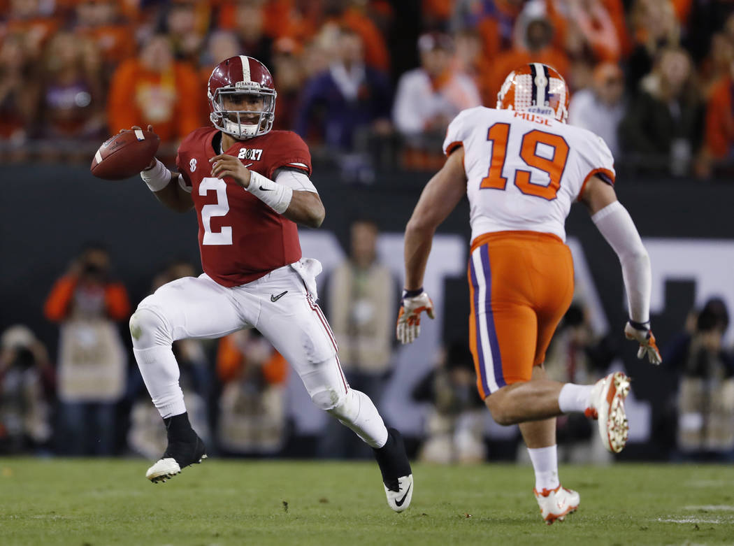 Alabama's Jalen Hurts scrambles during the second half of the NCAA college football playoff championship game against Clemson Monday, Jan. 9, 2017, in Tampa, Fla. (AP Photo/John Bazemore)