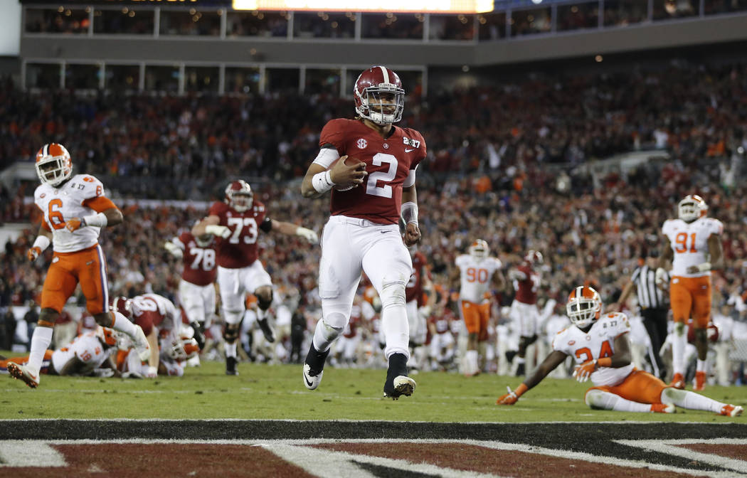 Alabama's Jalen Hurts runs for a touchdown during the second half of the NCAA college football playoff championship game against Clemson Tuesday, Jan. 10, 2017, in Tampa, Fla. (AP Photo/John Bazemore)