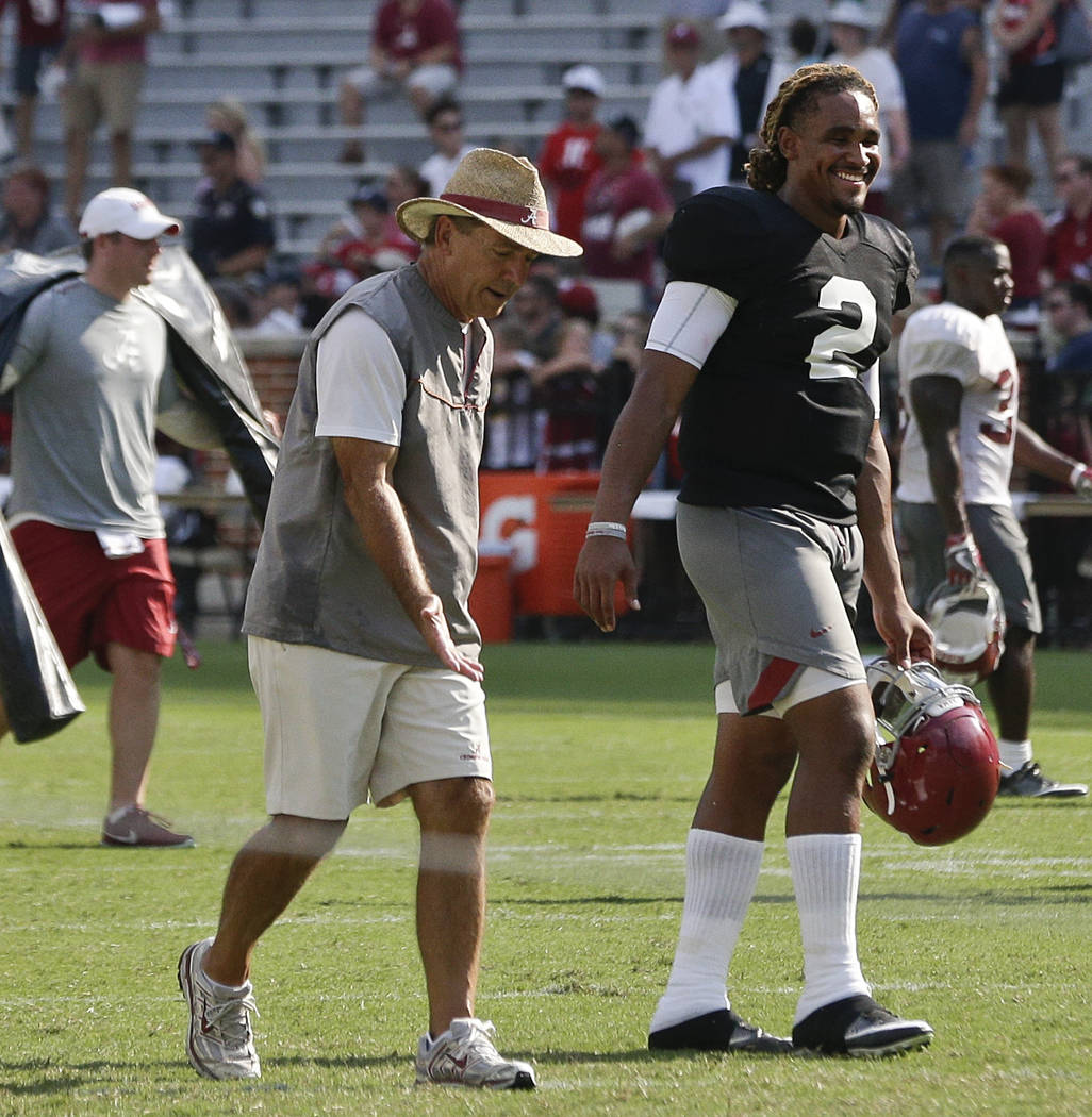 Alabama quarterback Jalen Hurts walks with coach Nick Saban during the NCAA college team's football fan day at Bryant–Denny Stadium, Saturday, Aug. 5, 2017, in Tuscaloosa, Ala. (AP Photo/Br ...