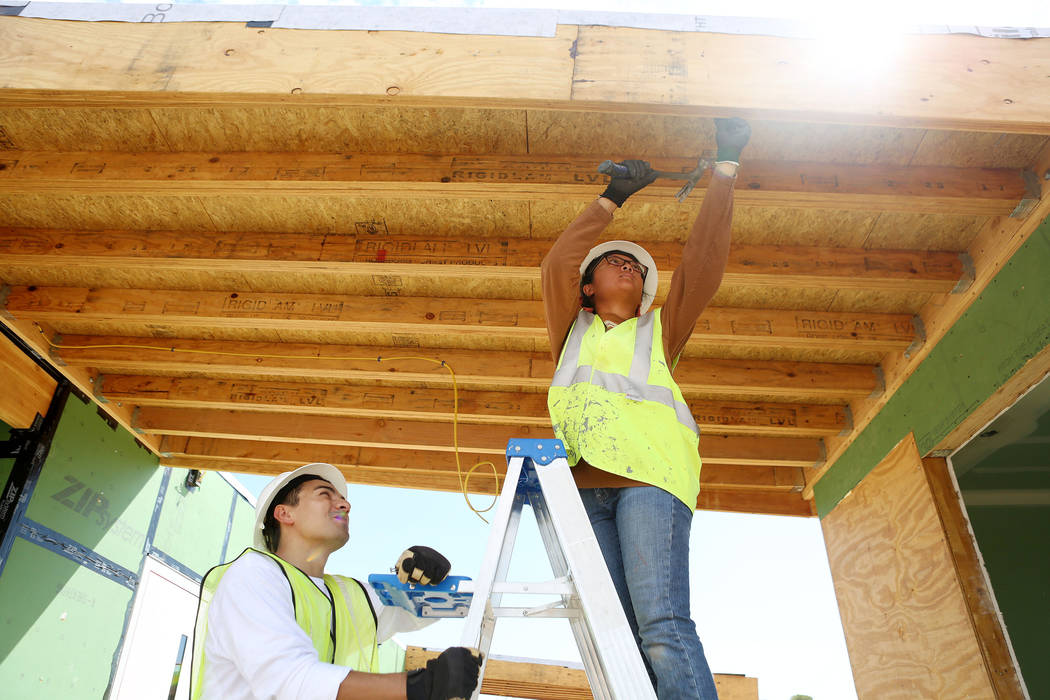 Architecture students Landon Baker, left, and Abbey Escala work on a solar-powered house which UNLV students design and build on UNLV's Paradise Campus in Las Vegas, Tuesday, Aug. 29, 2017. The UN ...