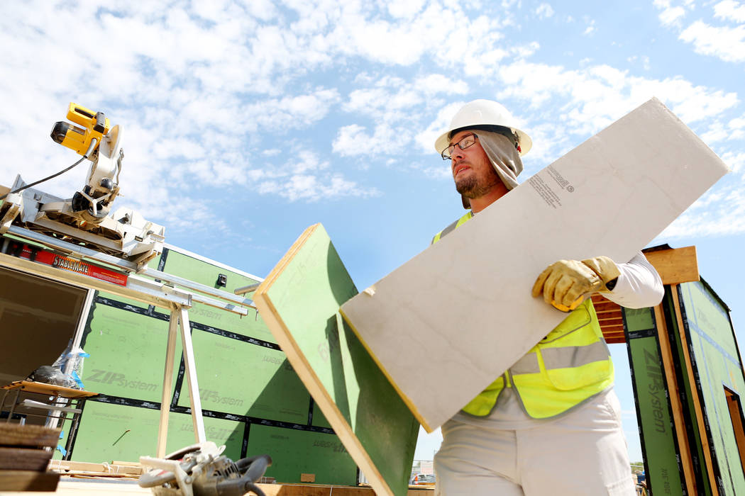 Mechanical engineering student Deric Larkin works on a solar-powered house which UNLV students design and build on UNLV's Paradise Campus in Las Vegas, Tuesday, Aug. 29, 2017. The UNLV's team of s ...
