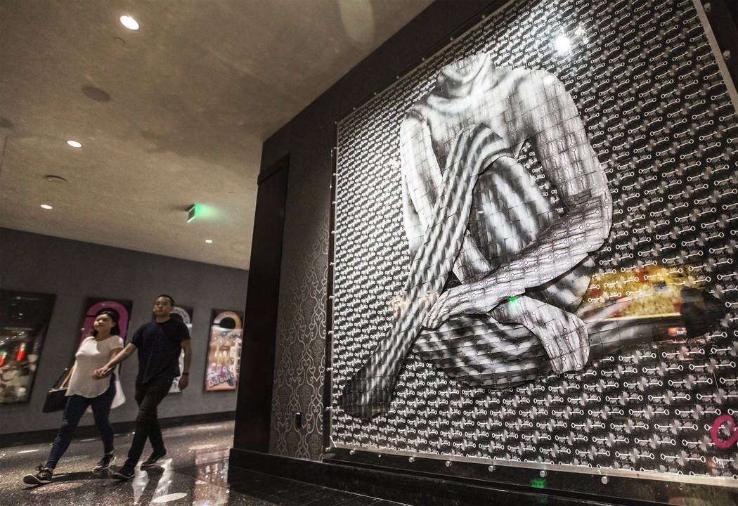 Guests at The Cosmopolitan hotel-casino pass artist Mallory Dawn's installation project made of hundreds of hotel room keys on Thursday, Aug 31, 2017, in Las Vegas. Benjamin Hager Las Vegas Review ...