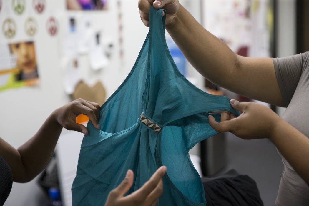 Clients look at a job interview outfit option at The Embracing Project in Las Vegas on Thursday, June 15, 2017. The nonprofit is a leading advocate for sexually exploited youths in Clark County. E ...