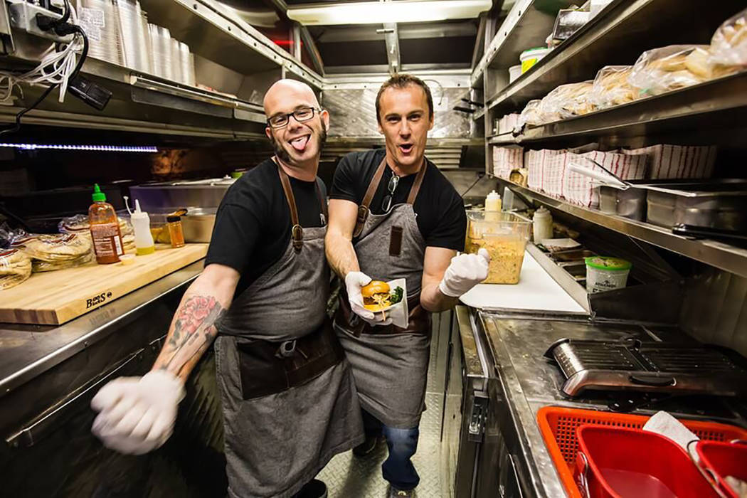 Chefs John Courtney, left, and Eric Lhuillier on a food truck. (Back of the House Brawl)