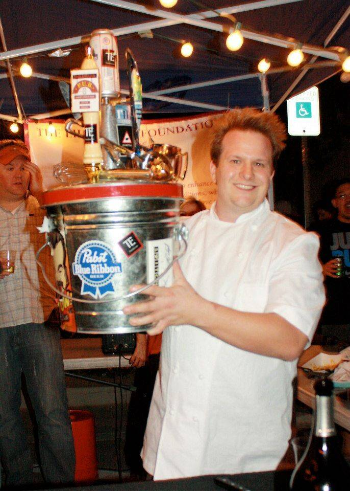 Back of the House Brawl Chef Brian Howard hoists the Pabst Blue Ribbon Cup trophy.