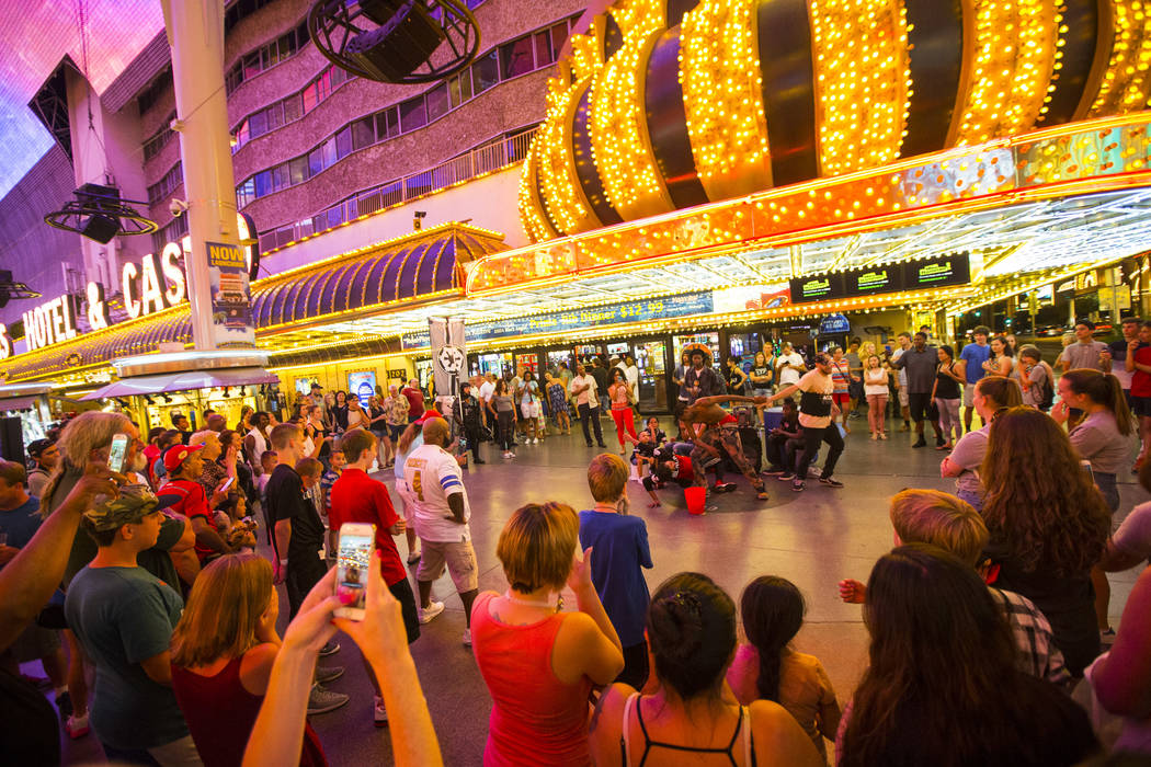 Bone-breaking buskers draw a crowd with their performance along the Fremont Street Experience in downtown Las Vegas on Thursday, Aug. 3, 2017. Chase Stevens Las Vegas Review-Journal @csstevensphoto