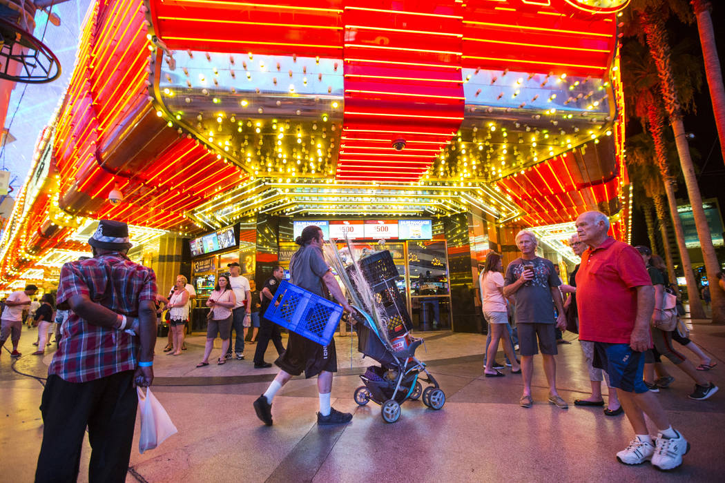 Busker Jason Mrdutt leaves his performance zone after being stopped by Las Vegas city marshals along the Fremont Street Experience in downtown Las Vegas on Wednesday, Aug. 2, 2017. Mrdutt said he  ...