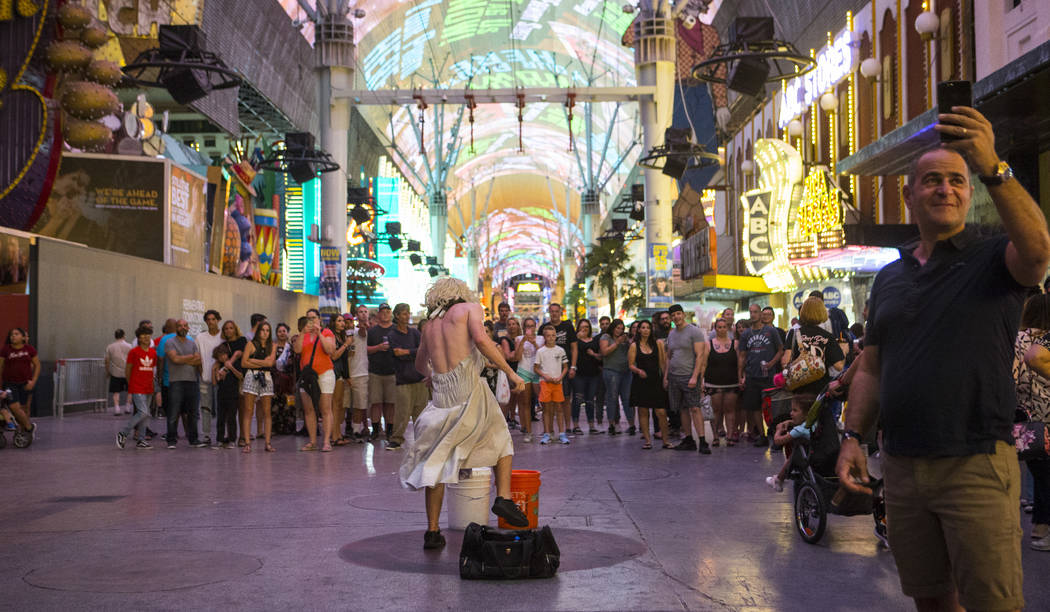 "A street performer who goes by ""Marylin Manrow"" draws a crowd on Fremont Street Experience in downtown Las Vegas on Wednesday, Aug. 2, 2017. Chase Stevens Las Vegas Review-Journa ..."