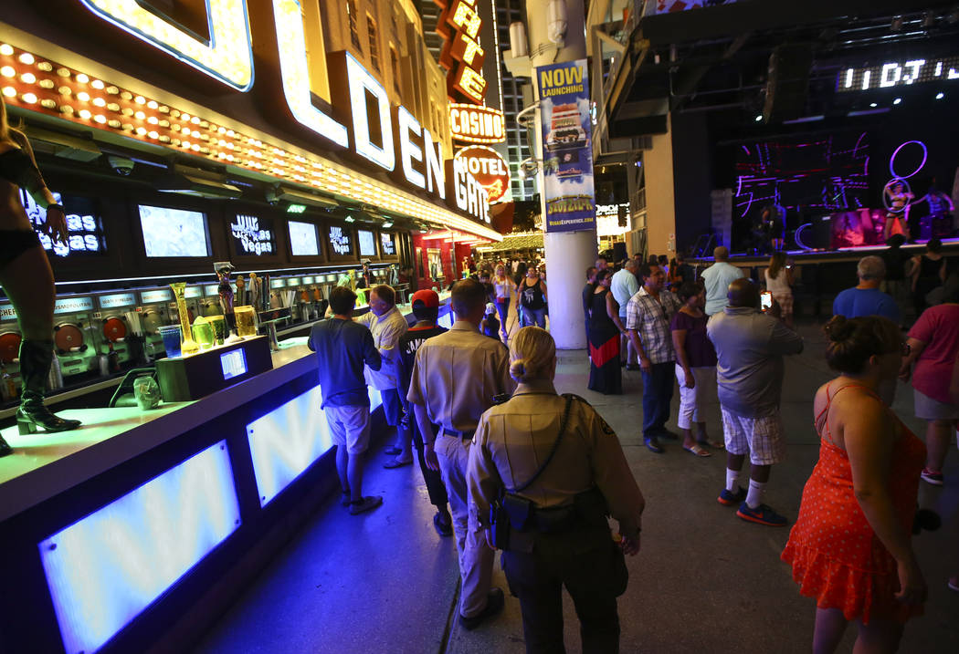 Security officers patrol along the Fremont Street Experience in downtown Las Vegas on Tuesday, Aug. 1, 2017. Chase Stevens Las Vegas Review-Journal @csstevensphoto