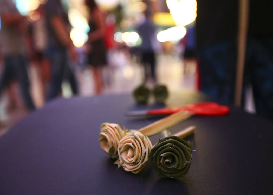 Roses made from palm tree fronds are one of many things buskers offer to tourists along the Fremont Street Experience in downtown Las Vegas on Tuesday, Aug. 1, 2017. Chase Stevens Las Vegas Review ...