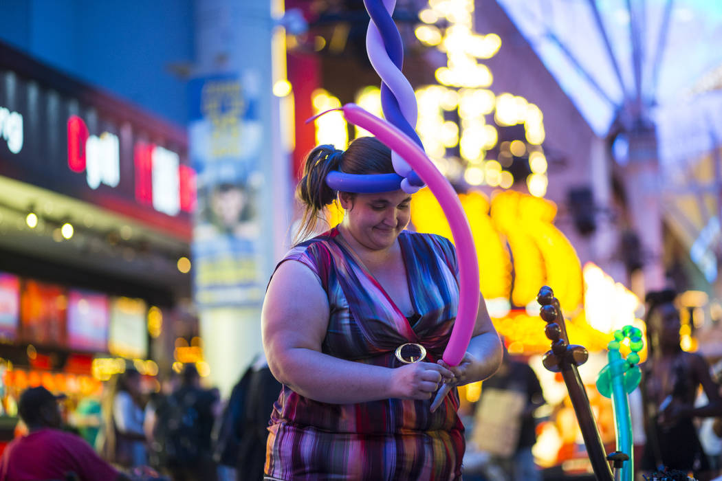 Balloon artist Heather Baressi, one of many buskers who offer a variety of items to tourists along the Fremont Street Experience, in downtown Las Vegas on Wednesday, Aug. 2, 2017. Chase Stevens La ...