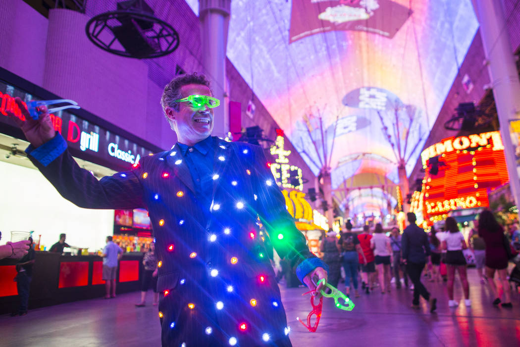 Busker Raul Castano looks to draw tourists along the Fremont Street Experience in downtown Las Vegas on Thursday, Aug. 3, 2017. Chase Stevens Las Vegas Review-Journal @csstevensphoto