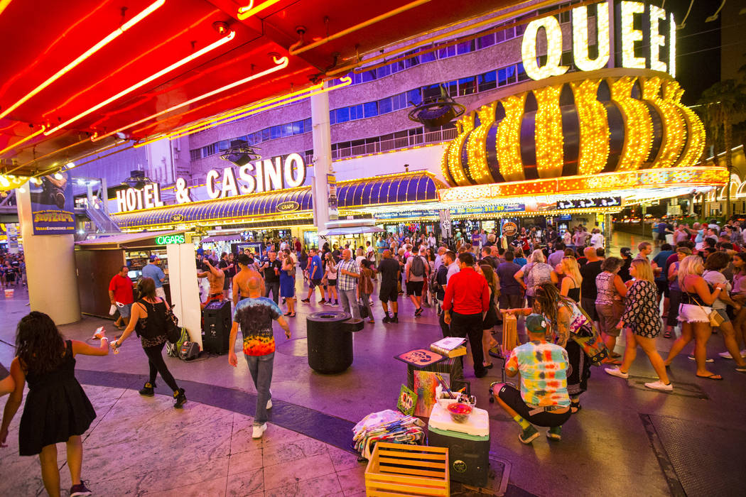 Buskers wait to move into a performance zone along the Fremont Street Experience in downtown Las Vegas on Thursday, Aug. 3, 2017. Chase Stevens Las Vegas Review-Journal @csstevensphoto