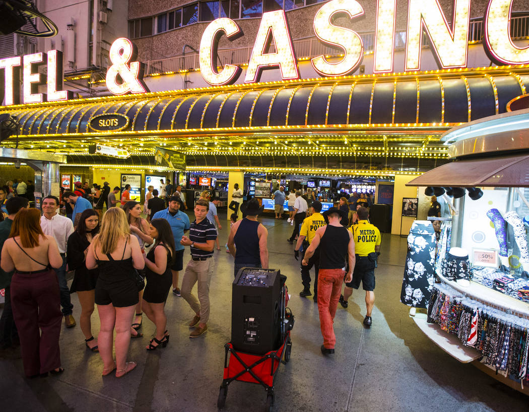 A pair of buskers are moved from their performance zone by Las Vegas city marshals along the Fremont Street Experience in downtown Las Vegas on Thursday, Aug. 3, 2017. Chase Stevens Las Vegas Revi ...