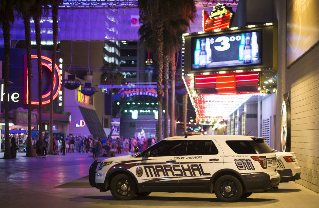 Las Vegas city marshal squad cars along 3rd Street off of the Fremont Street Experience in downtown Las Vegas on Wednesday, Aug. 2, 2017. The officers, with the help of the tourist district's secu ...