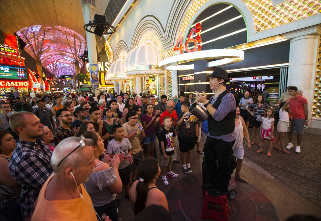 Magician Sean Scott performs along the Fremont Street Experience in downtown Las Vegas on Tuesday, Aug. 1, 2017. Chase Stevens Las Vegas Review-Journal @csstevensphoto