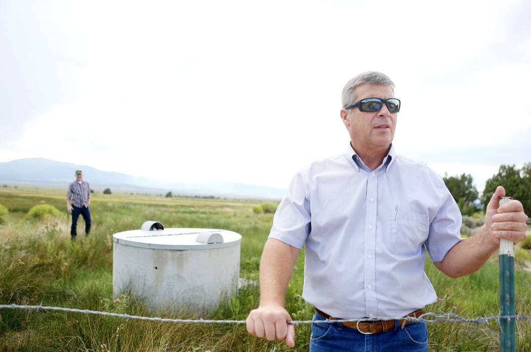 Ranch and resource manager Bernard Petersen explains one of the wells that feeds Shoshone Ponds flows on the Great Basin Ranch in Spring Valley, Monday, Aug. 7, 2017. Elizabeth Brumley Las Vegas R ...