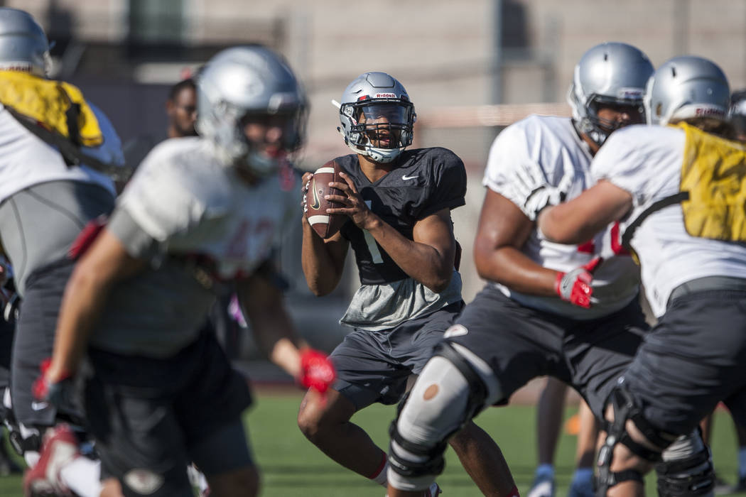 UNLV quarterback Armani Rogers looks to pass during training camp at Rebel Park on Monday, Aug. 14, 2017.  Patrick Connolly Las Vegas Review-Journal @PConnPie