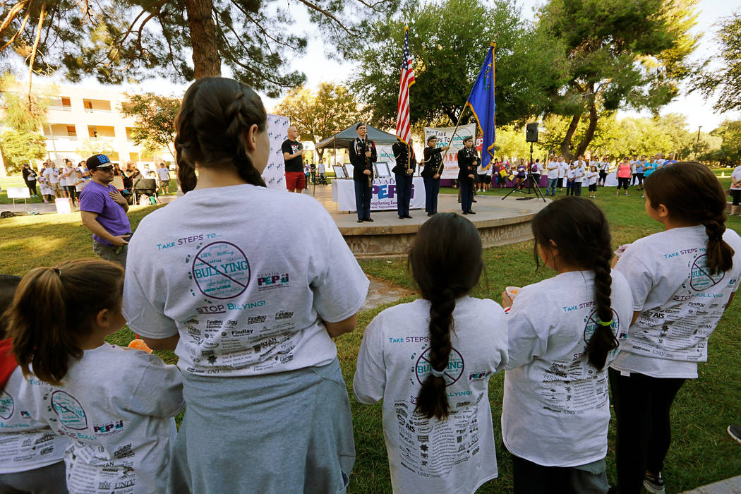 A Las Vegas High School junior ROTC color guard displays the flag  during the national anthem at the annual Run Walk Roll Against Bullying at UNLV in Las Vegas, Saturday, Sept. 30, 2017. Chitose S ...