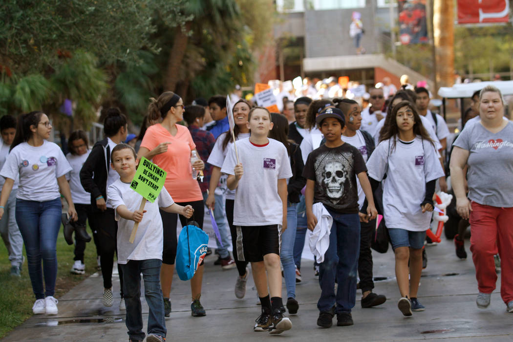 Keller Middle School students and other attendees move to the starting line before the 1.5 mile Fun Walk & Roll during the annual Run Walk Roll Against Bullying at UNLV in Las Vegas, Saturday, ...