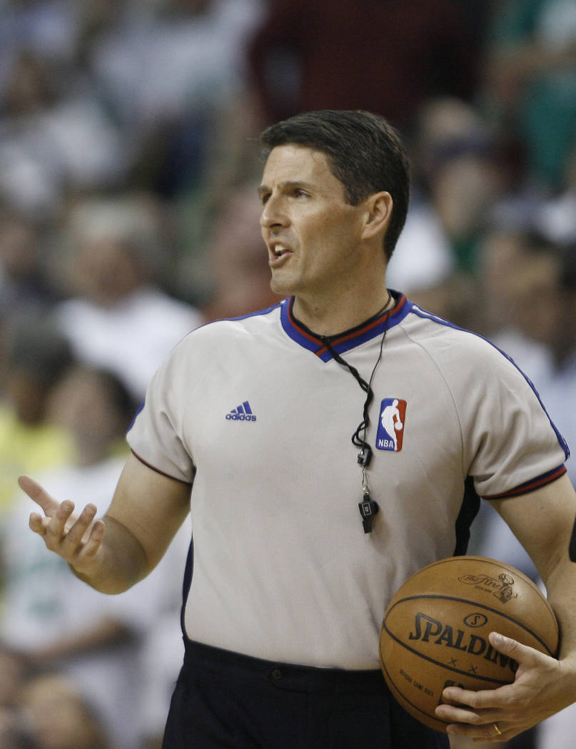 This June 5, 2008 file photo shows NBA referee Scott Foster gesturing during Game 1 of the NBA basketball finals in Boston. Foster broke his silence Tuesday Nov. 4, 2008, discussing his role in th ...