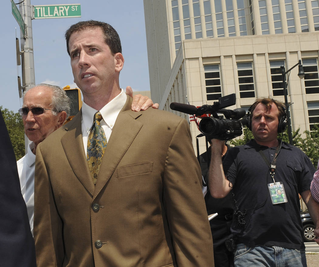 Former NBA referee Tim Donaghy exits Brooklyn federal court following his sentencing, Tuesday, July 29, 2008, in New York. Donaghy received a prison sentence of fifteen months and three years prob ...