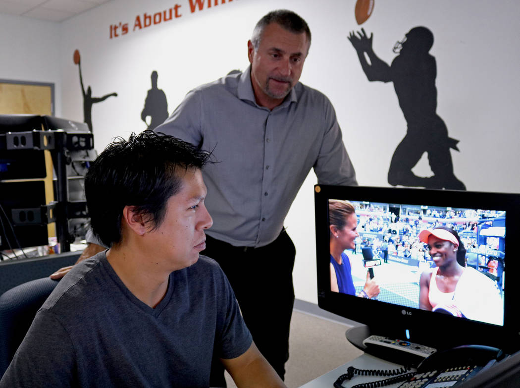 Sports analyst Diego Jordan, left, and Vice President of Data Integrity, Kenny White, look over the numbers from the US Open for tennis matches at Don Best Sport in Las Vegas, Tuesday, Sept. 5, 20 ...