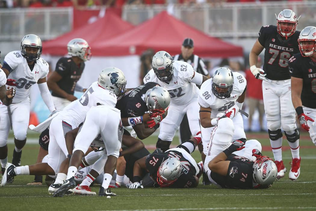 UNLV running back Charles Williams (8) is taken down by Howard during a football game at Sam Boyd Stadium in Las Vegas on Saturday, Sept. 2, 2017. Chase Stevens Las Vegas Review-Journal @csstevens ...