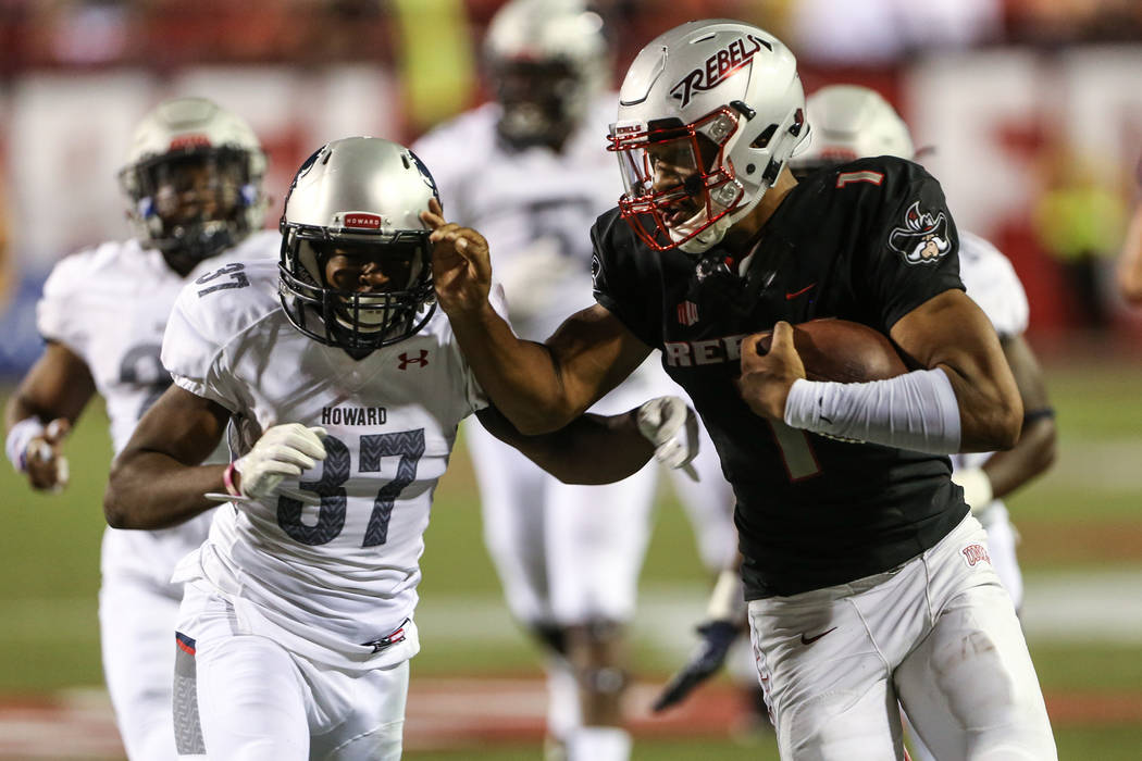 Howard Bison defensive back Charles Robinson (37) is spiff armed by UNLV quarterback Armani Rogers (1) during the third quarter at Sam Boyd Stadium in Las Vegas, Saturday, Sept. 2, 2017. Joel Ange ...