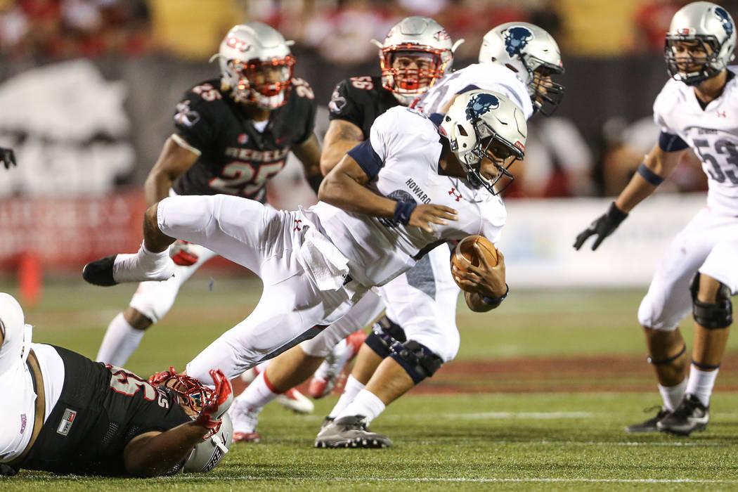 Howard Bison quarterback Caylin Newton (3) is tackled by UNLV defensive lineman Jason Fao (95) during the third quarter at Sam Boyd Stadium in Las Vegas, Saturday, Sept. 2, 2017. Joel Angel Juarez ...