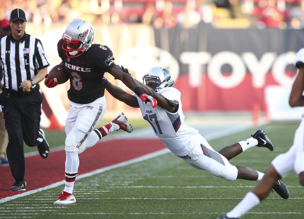 UNLV running back Charles Williams (8) is forced out of bounds by Howard defensive back Tye Freeland (17) during a football game at Sam Boyd Stadium in Las Vegas on Saturday, Sept. 2, 2017. Chase  ...